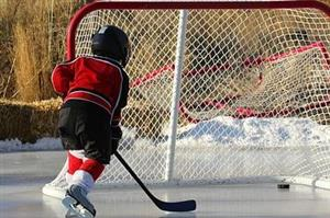 Youth Hockey Player Taking a Shot